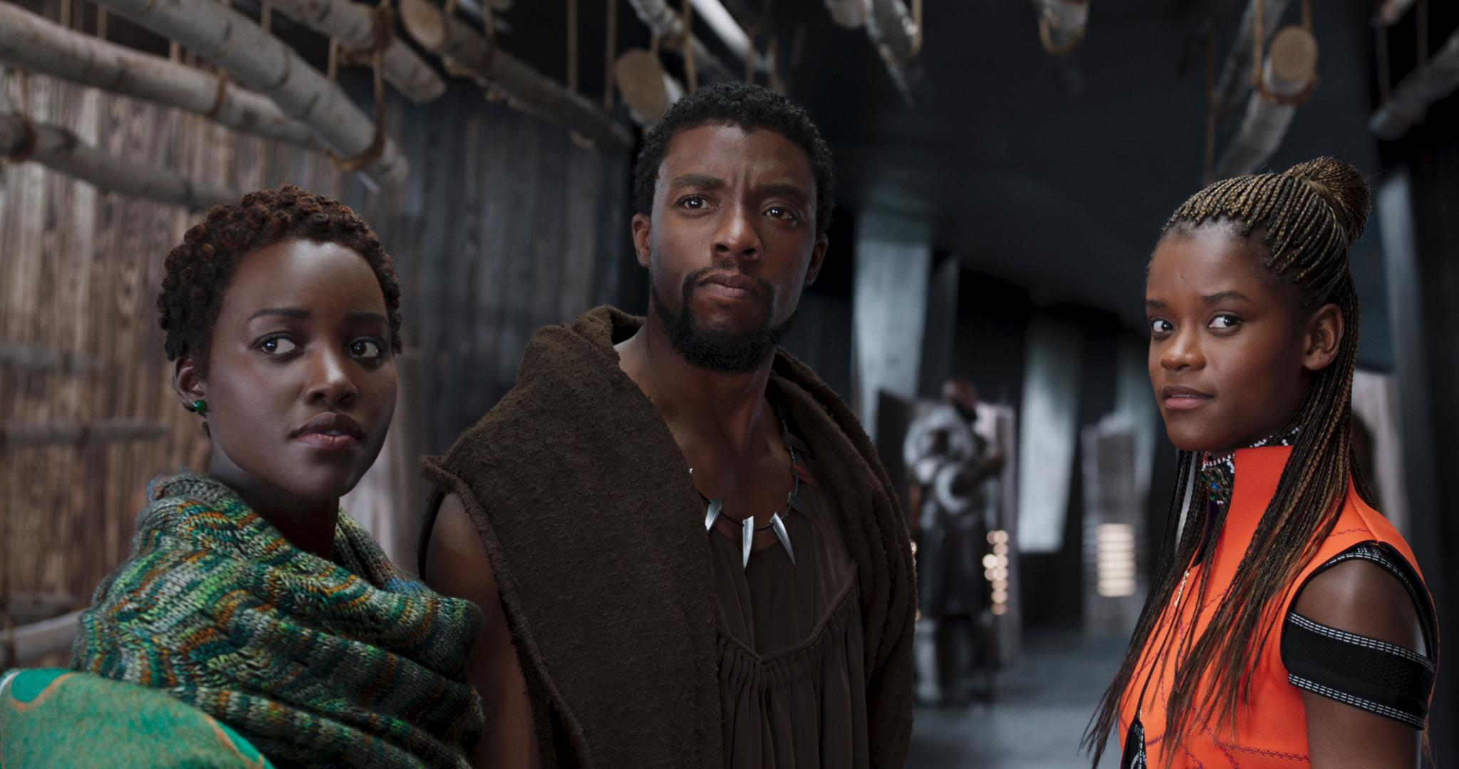 "This image released by Disney shows Lupita Nyong'o, from left, Chadwick Boseman and Letitia Wright in a scene from ""Black Panther."" (Disney via AP)"