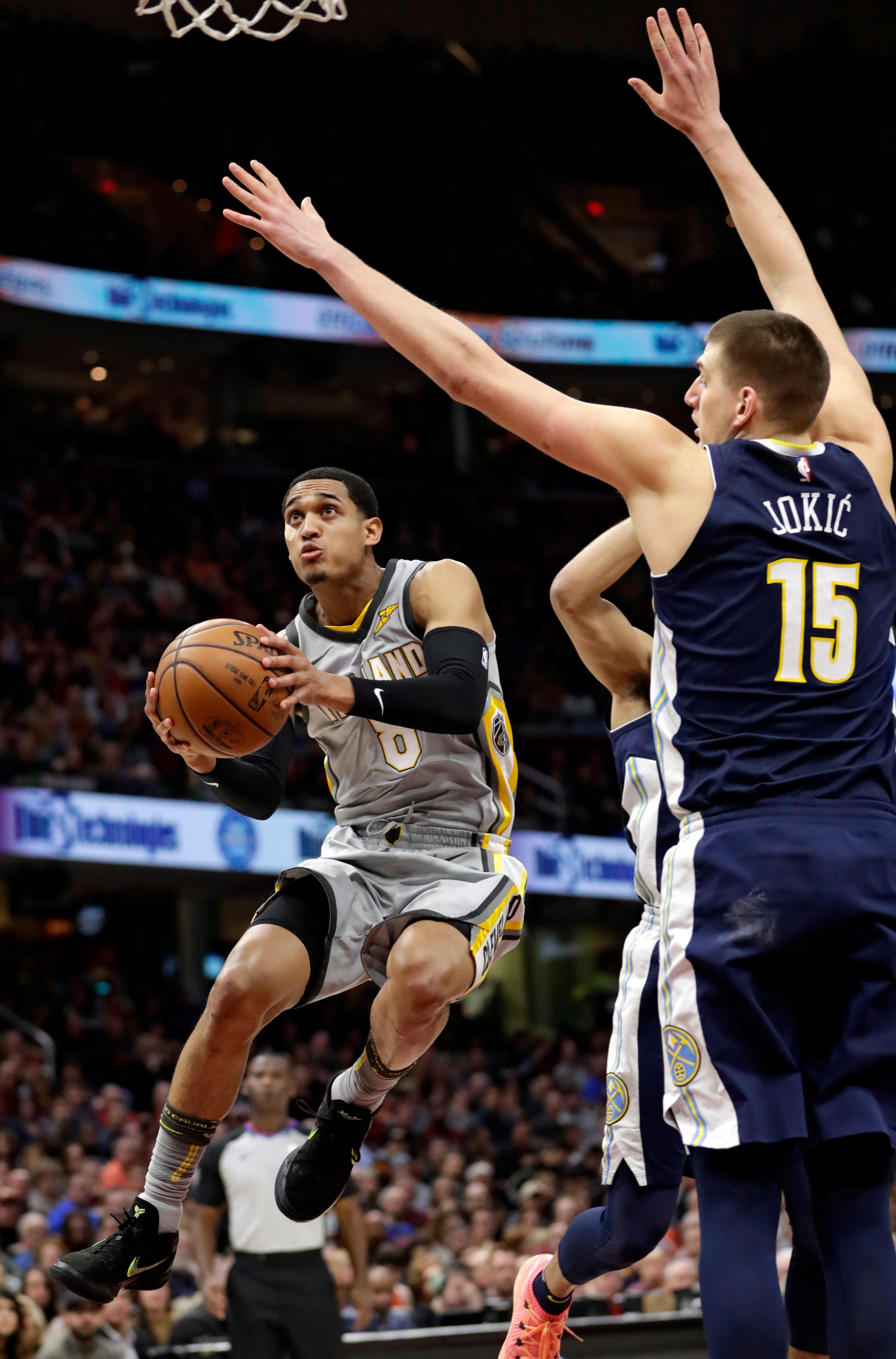 Cleveland Cavaliers' Jordan Clarkson (8) drives to the basket against Denver Nuggets' Nikola Jokic, from Serbia, in the first half of an NBA basketball game, Saturday, March 3, 2018, in Cleveland. (AP Photo/Tony Dejak)