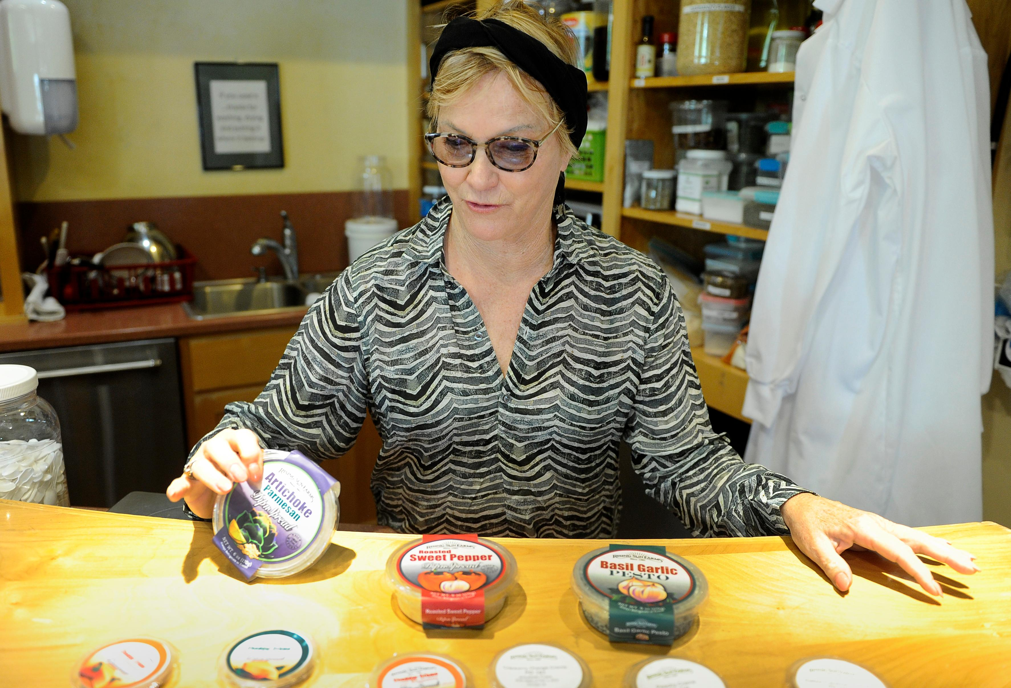 Andy Atkinson / Mail TribuneElizabeth Fujas says the Artichoke-Parmesan Dip'nSpread is one of her favorites along with other products at Rising Sun Farms in Phoenix.