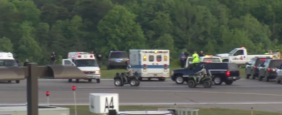Yeager emergency vehicles flank the runway Friday after a double fatal plane crash. (WCHS/WVAH)