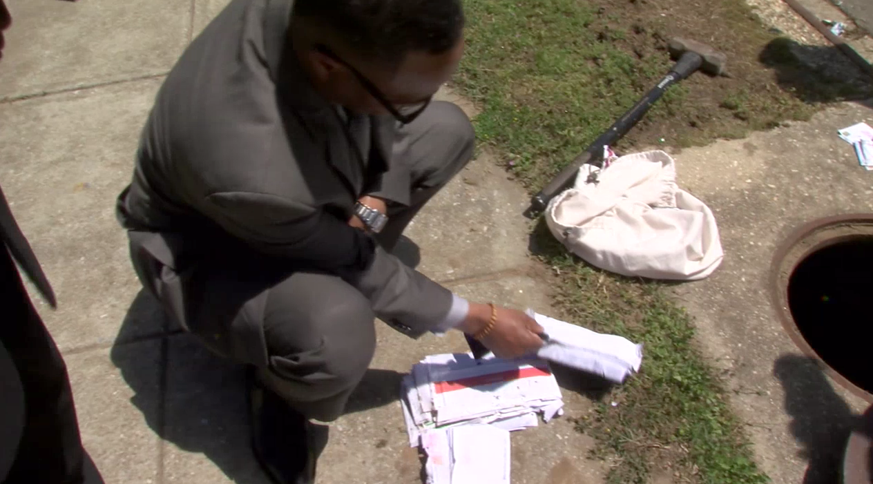 Residents in northeast Washington question if their missing mail was tossed down drains. (ABC7 photo)