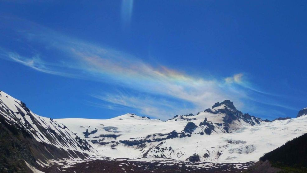 Rainbows in the clouds? Sun, ice crystals combine for colorful sky show over Seattle
