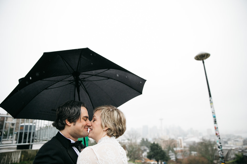 "Ryan & Tracey wed in February and had a beautiful and quintessential ""rainy day in Seattle"" wedding. The couple strolled through Seattle, stopping to snap some photos at iconic Seattle locations such as The Pink Elephant Car Wash, Kerry Park, and Archie McPhee. Ryan and Tracey also rolled around in a Big Woody Bus and held their ceremony at Ivar's Salmon House. How cute is that?! Click through the gallery and get wedding inspo, or to just gaze upon the beauty that is this glorious wedding. Do you or somebody you know have a wedding you think deserves the spotlight? We LOVE (pun intended) documenting love stories, so email us at hello@seattlerefined.com to submit some wedding or engagement shots! (Image: Jenny GG Photography)"