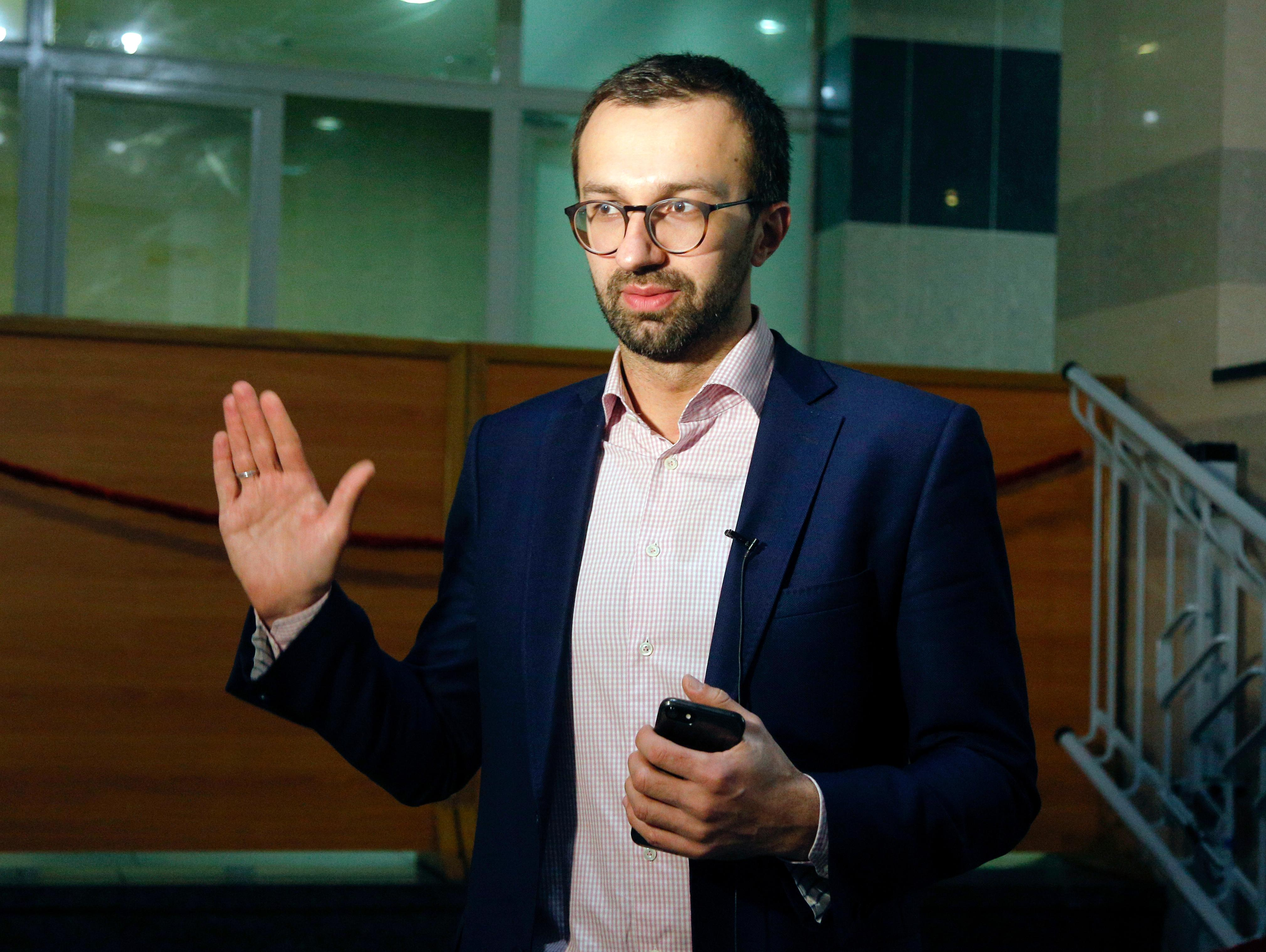 FILE - In this file photo dated Friday, Nov. 3, 2017, Ukrainian lawmaker Serhiy Leshchenko gestures, during an interview with the Associated Press in Kiev, Ukraine.  Ukrainian opposition lawmaker Serhiy Leshchenko, who helped uncover off-the-books payments to President Donald Trump's former campaign chairman Paul Manafort, said Saturday Feb. 24, 2018,  that Austrian chancellor Alfred Gusenbauer had lobbied for Ukraine when Yanukovych was in power, although Gusenbauer told the Austrian national news agency APA that he never acted on Yanukovych's behalf. (AP Photo/Efrem Lukatsky, FILE)