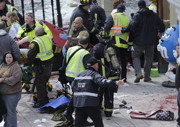 Medical workers at scene of explosion near Boston Marathon finish line.