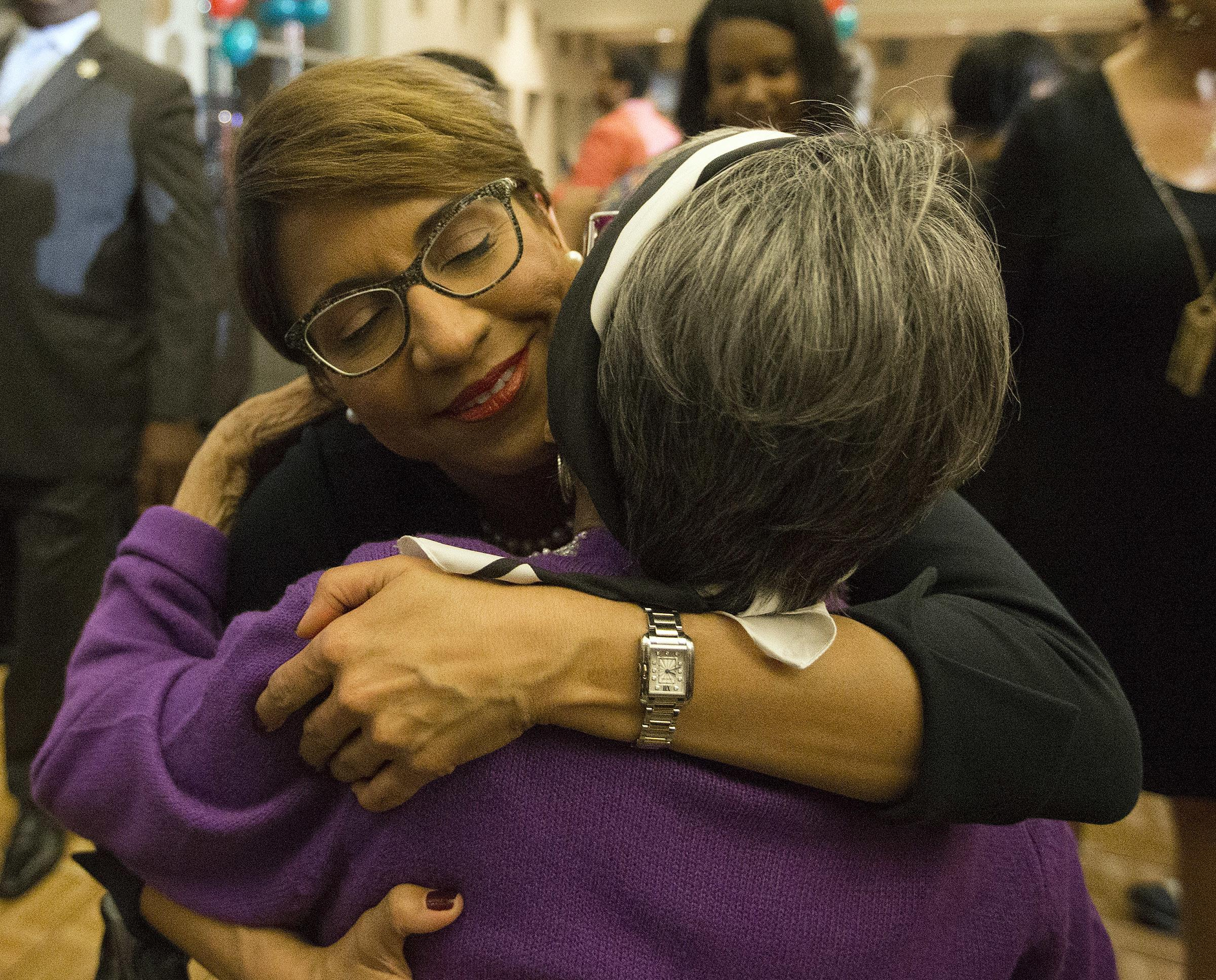 Former municipal Judge Desiree Charbonnet hugs her mother, Gloria Charbonnet, after she conceded to LaToya Cantrell in the New Orleans mayoral race at the Sheraton Hotel in New Orleans, Saturday, Nov. 18, 2017. (David Grunfeld/NOLA.com The Times-Picayune via AP)