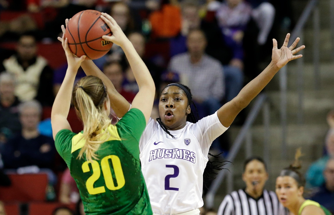 Washington's Aarion McDonald (2) defends Oregon's Sabrina Ionescu in the first half of an NCAA college basketball game in the Pac-12 tournament, Friday, March 3, 2017, in Seattle. (AP Photo/Elaine Thompson)
