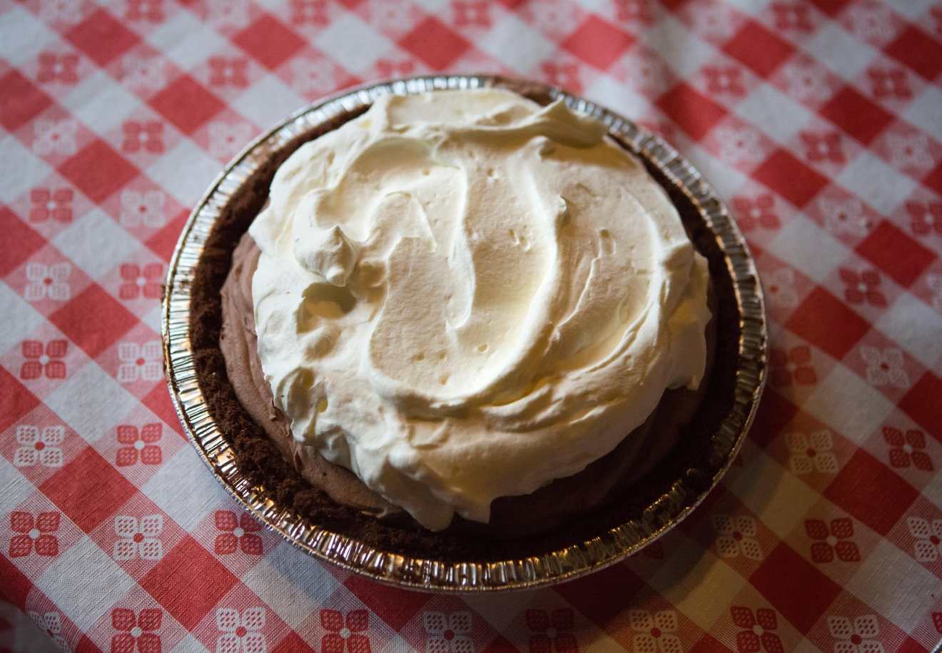 A chocolate pie from A la Mode Pies waits to be devoured before the second annual Pi Day Pie Eating Contest at Lost Lake Cafe. The winner of the competition got to choose a charity of their choice to receive $500. (Sy Bean / Seattle Refined)
