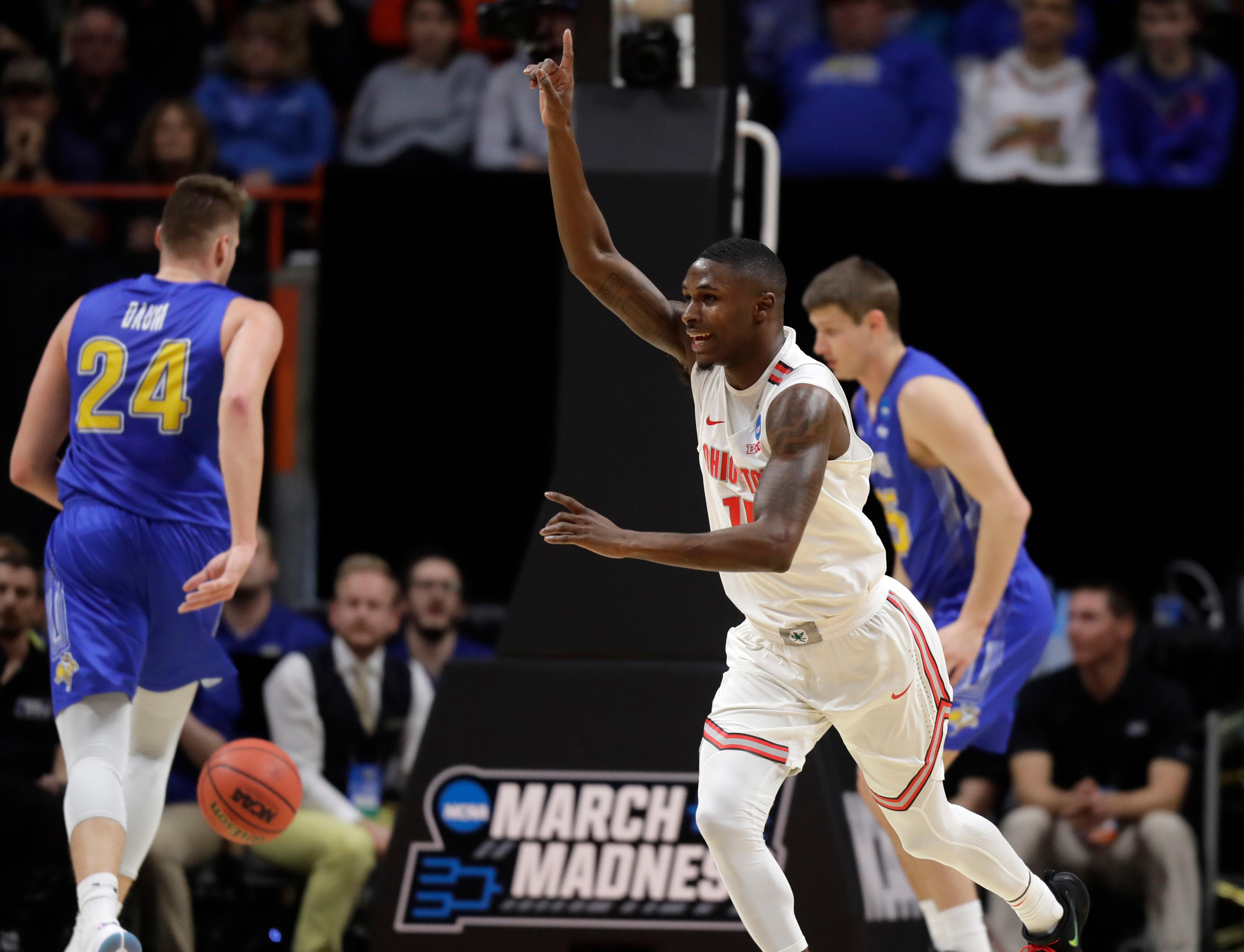 Ohio State guard Kam Williams, center, reacts after scoring during the first half of a first-round game against South Dakota State in the NCAA college basketball tournament, Thursday, March 15, 2018, in Boise, Idaho. (AP Photo/Ted S. Warren)