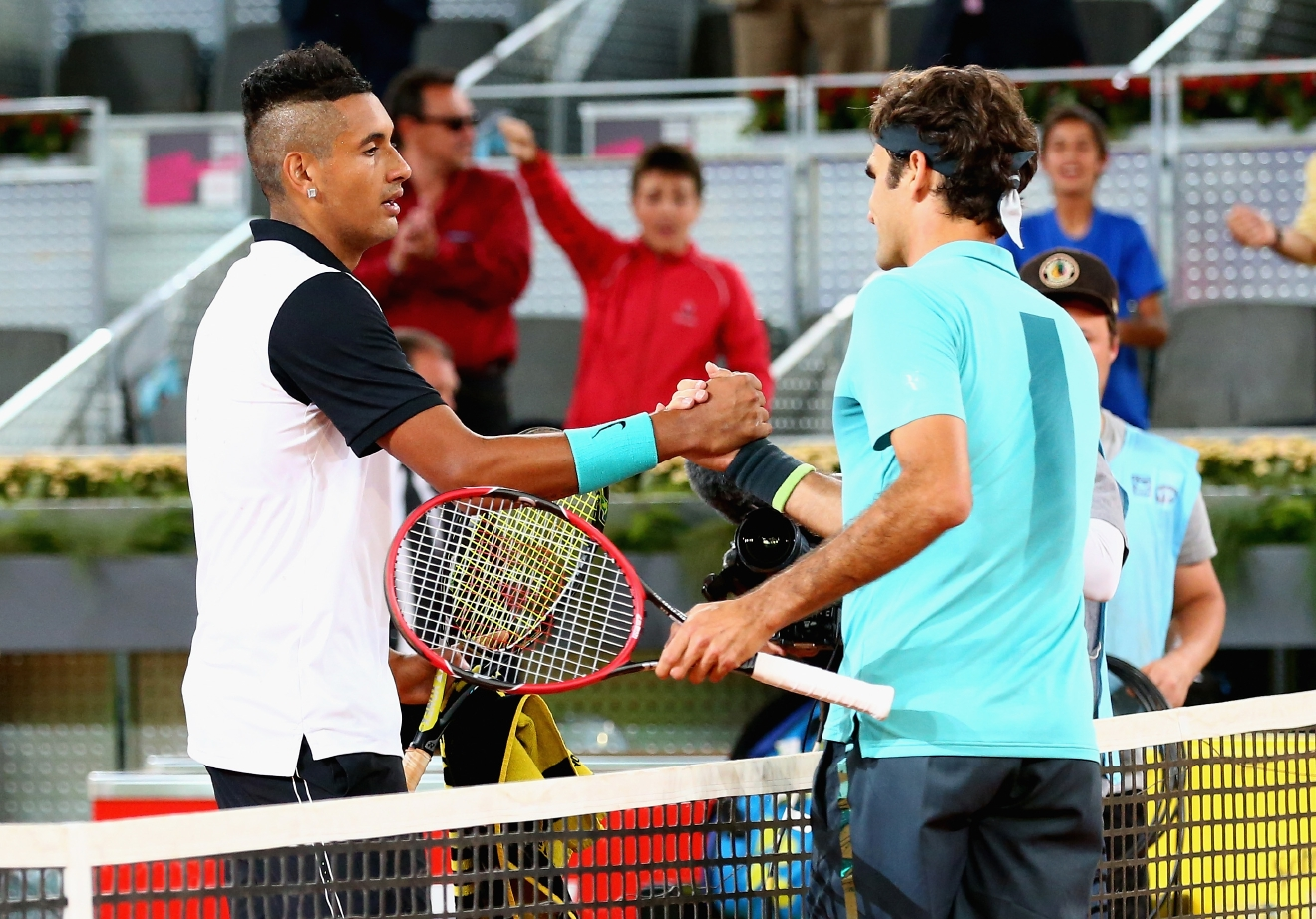 MADRID, SPAIN - MAY 06:  Nick Kyrgios of Australia shakes hands at the net after his three set victory against Roger Federer of Switzerland in their second round match during day five of the Mutua Madrid Open tennis tournament at the Caja Magica  on May 6, 2015 in Madrid, Spain.  (Photo by Clive Brunskill/Getty Images)
