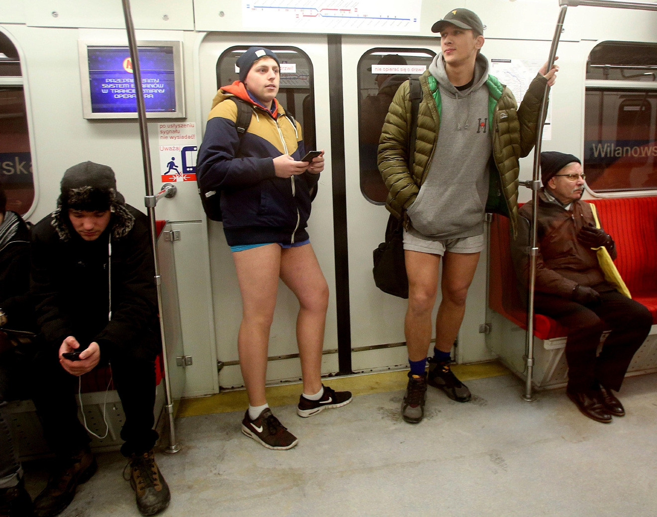 Young people riding on the subway with no pants on as they join a global happening in Warsaw, Poland, Sunday, Jan. 8, 2017, amid freezing winter weather outside. (AP Photo/Czarek Sokolowski)