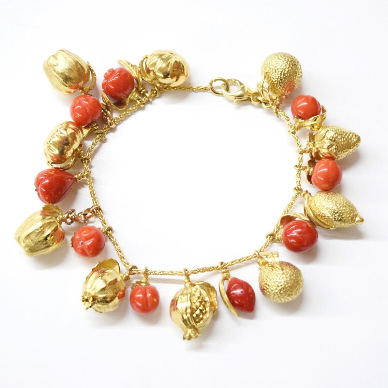 Argentine 18K and Coral Bracelet with Fruit Charms / Image courtesy of Everything But The House // Published: 10.15.16