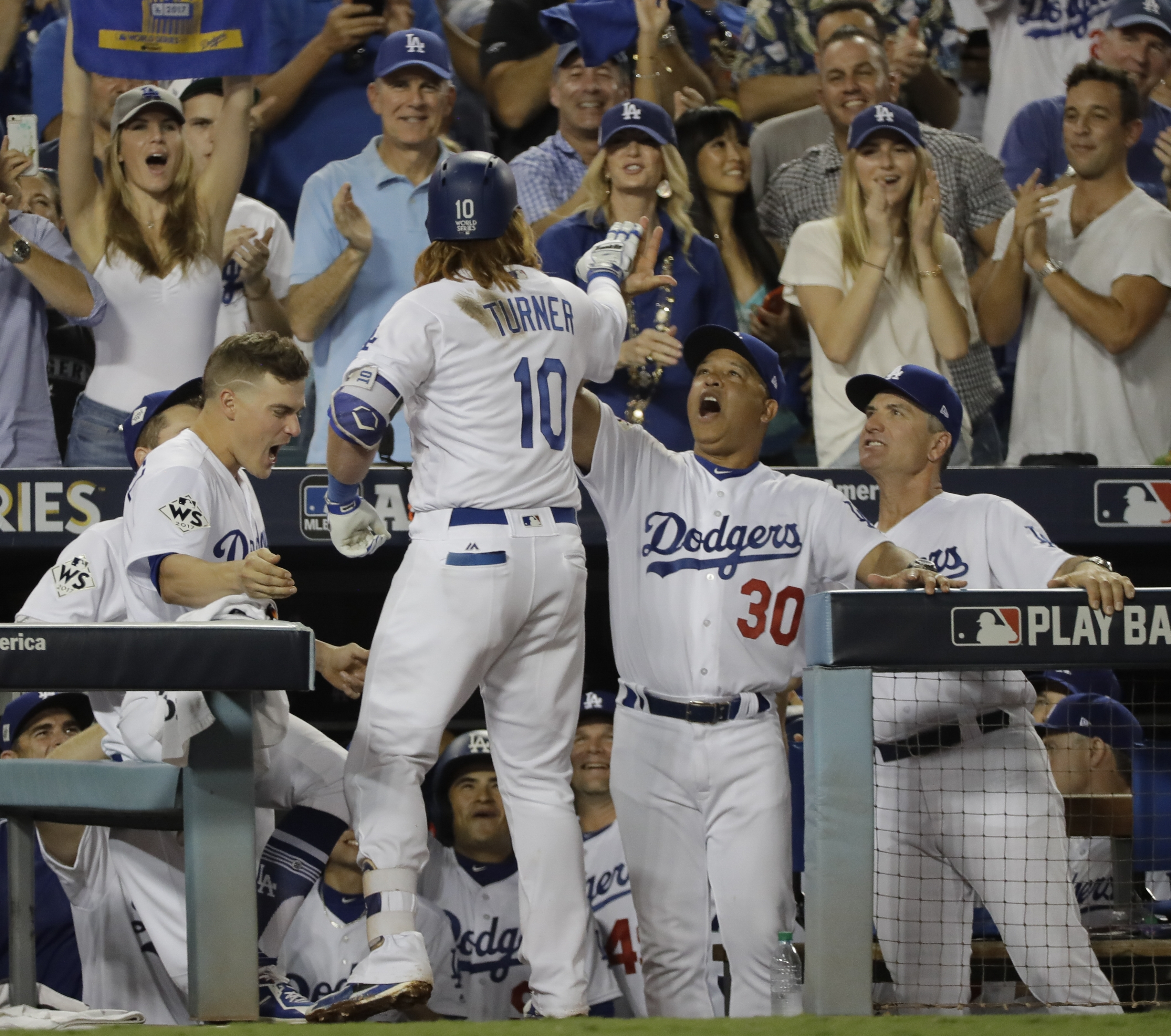 Los Angeles Dodgers' Justin Turner celebrates his two-run home run during the sixth inning of Game 1 of baseball's World Series against the Houston Astros Tuesday, Oct. 24, 2017, in Los Angeles. (AP Photo/David J. Phillip)