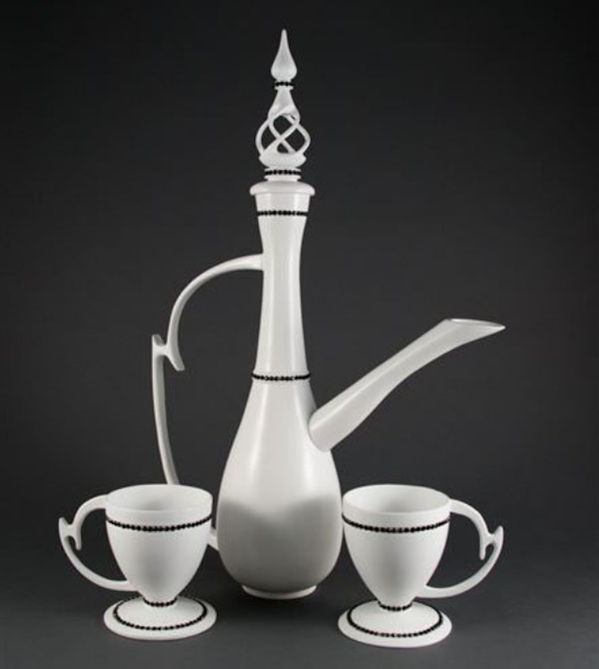 <p>This tea set{&amp;nbsp;}by Nancy Bowman was hollowed on a lathe and then the handles and teapot lid were carved. The set was then lacquered soft white and trimmed in black Swarovski Crystals. / Image: Nancy Bowman{&amp;nbsp;}// Published: 4.18.19</p>