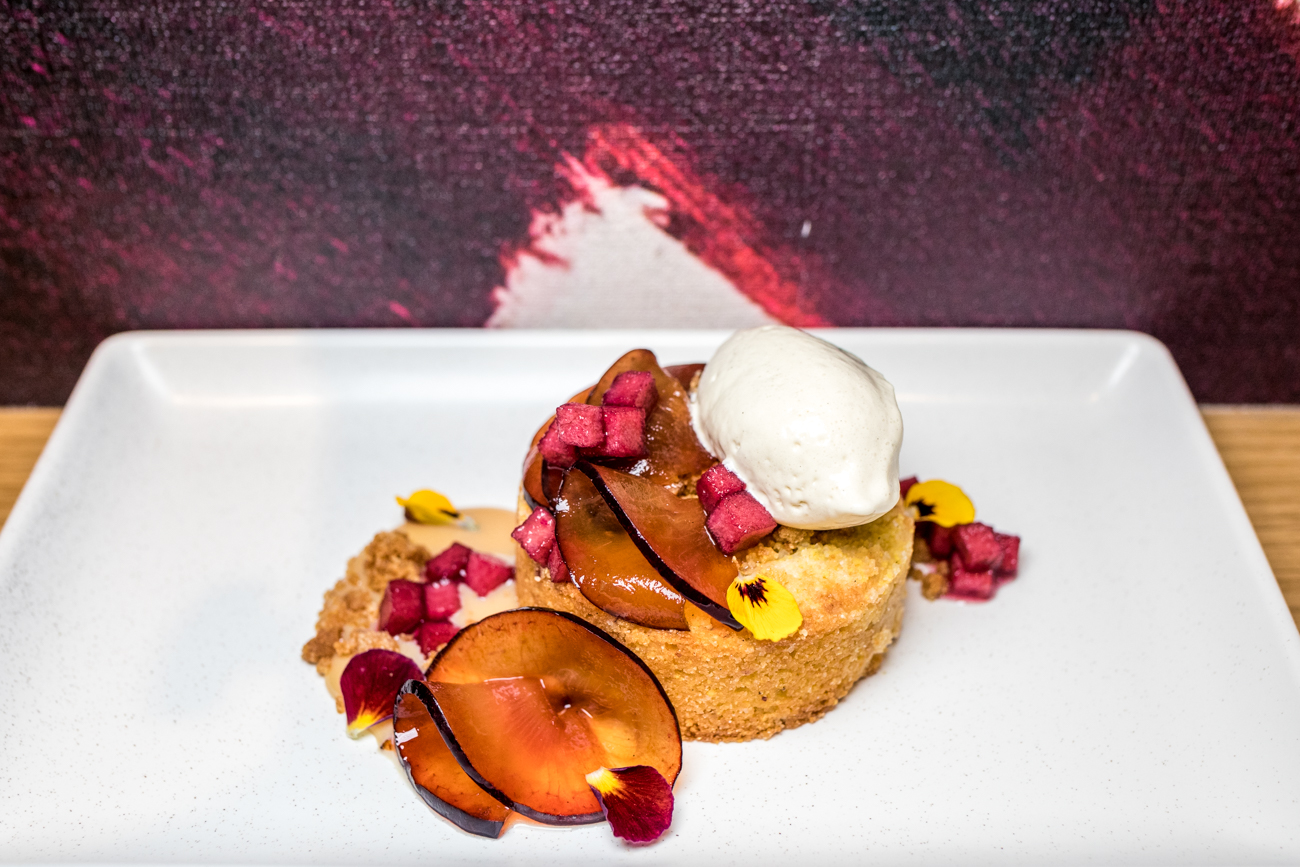 Cornmeal Cake: ras el hanout ice cream, cardamom plums, concord honey crisp, and caramelized milk jam / Image: Catherine Viox{ }// Published: 11.18.20
