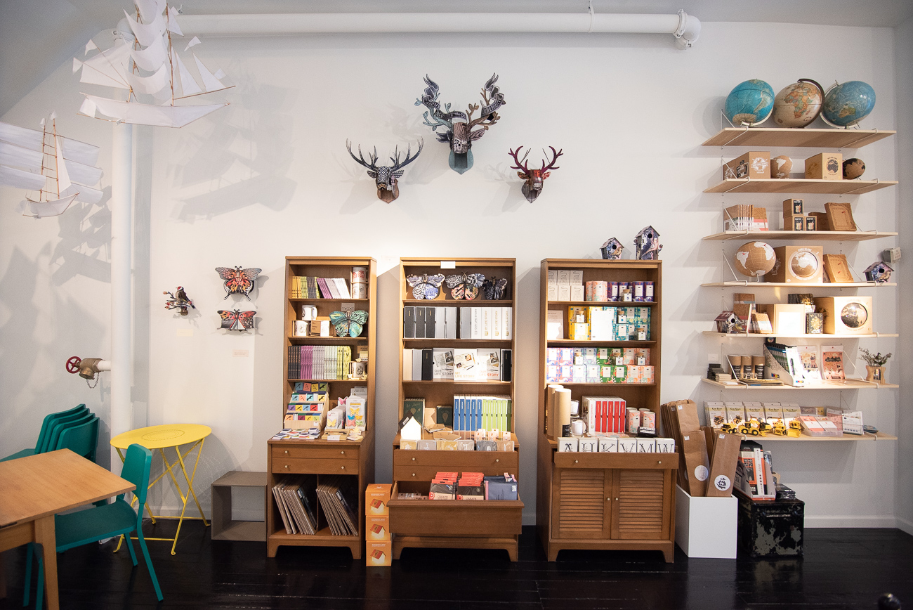 "Carolyn Deininger loves paper goods. The demand for paper goods at her other Vine Street store in OTR, MiCA, kept growing. As a result, she opened Paper Wings two doors down. The store sells ""utilitarian pieces of art for everyday use."" Cards for any occasion, notebooks, paper-based accessories, and other beautiful home and office supplies make up the bulk of the inventory for the shop. Furthermore, Carolyn buys from indie designers and makers who hand-make their products. Almost always, the designers are either local or within the US. ADDRESS: 1207 Vine Street (45202) / Image: Phil Armstrong, Cincinnati Refined // Published: 8.21.19"