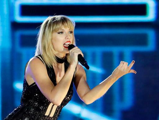 "FILE - In this Oct. 22, 2016 photo, Taylor Swift performs in Austin, Texas. Ninety-six-year-old Cyrus Porter is a devoted Taylor Swift fan and has traveled to her shows, but on Monday, Dec. 26 2016, he didn't have to go anywhere, Swift came to him. Swift had learned about the World War II combat veteran's fandom and decided to surprise him. A day after Christmas a van carrying Swift pulled into the driveway of his home in New Madrid, Mo. The singer stayed about an hour and sang ""Shake It Off"" as Porter's relatives sang along. (AP Photo/Darron Cummings, File)"